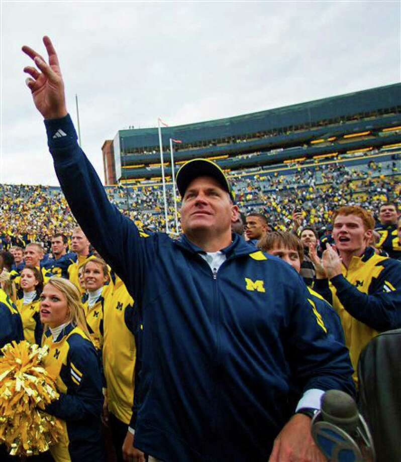 Michigan coach Rich Rodriguez waves to fans in Michigan Stadium after Michigan's 30-10 win over Connecticut in an NCAA college football game Saturday, Sept. 4, 2010, in Ann Arbor. (AP Photo/Tony Ding) Photo: Tony Ding, AP / © ASSOCIATED PRESS