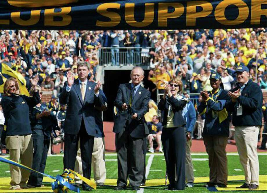 From center left to right, Michigan athletic director David Brandon, former athletic director Bill Martin, and university president Mary Sue Coleman officially re-dedicate Michigan stadium with members of the Board of Regents, before an NCAA college football game, Saturday, Sept. 4, 2010, in Ann Arbor, Mich. After a three-year, $226 million renovation, the Big House is now bigger than ever, reclaiming the country's title as largest college football stadium in capacity. (AP Photo/Tony Ding) Photo: Tony Ding, AP / © ASSOCIATED PRESS