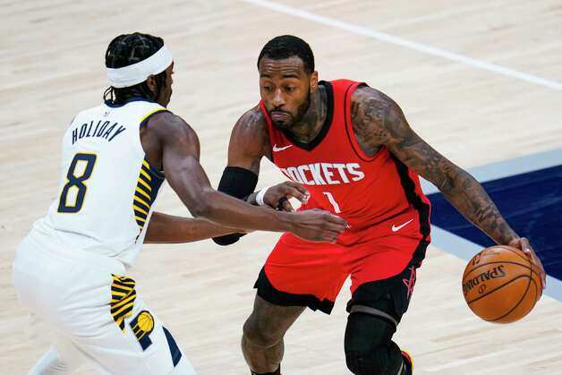 Houston Rockets guard John Wall (1) drives on Indiana Pacers guard Justin Holiday (8) during the fourth quarter of an NBA basketball game in Indianapolis, Wednesday, Jan. 6, 2021. (AP Photo/Michael Conroy) Photo: Michael Conroy, Associated Press / Copyright 2021 The Associated Press. All rights reserved.