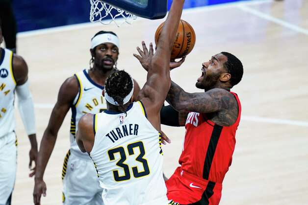 Houston Rockets guard John Wall (1) shoots over Indiana Pacers forward Myles Turner (33) during the fourth quarter of an NBA basketball game in Indianapolis, Wednesday, Jan. 6, 2021. (AP Photo/Michael Conroy) Photo: Michael Conroy, Associated Press / Copyright 2021 The Associated Press. All rights reserved.