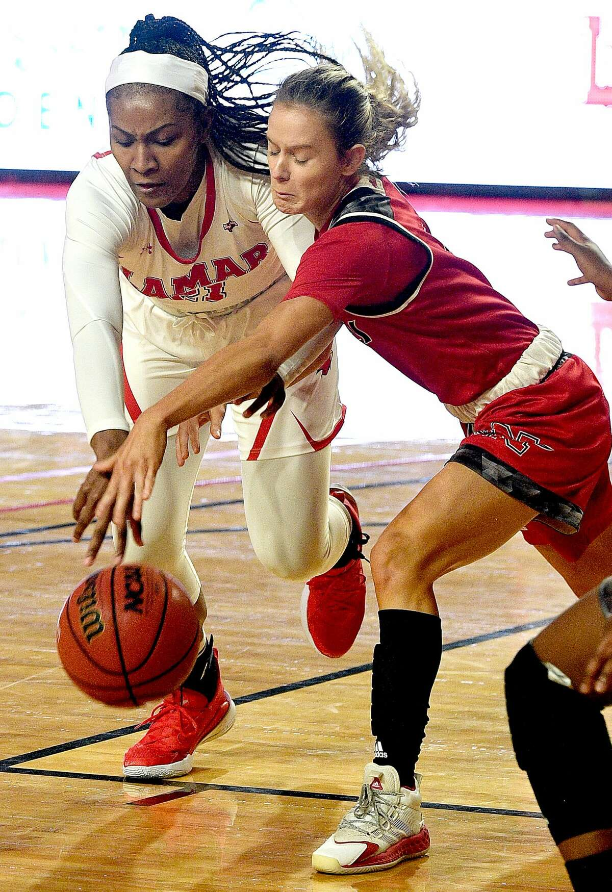 Lamar's Anyssia Gibbbs tries to maintain control as Nicholls State's Anna McKendree looks for the steal in their Southland Conference game opener at the Montagne Center Wednesday. Photo taken Wednesday, January 6, 2021 Kim Brent/The Enterprise