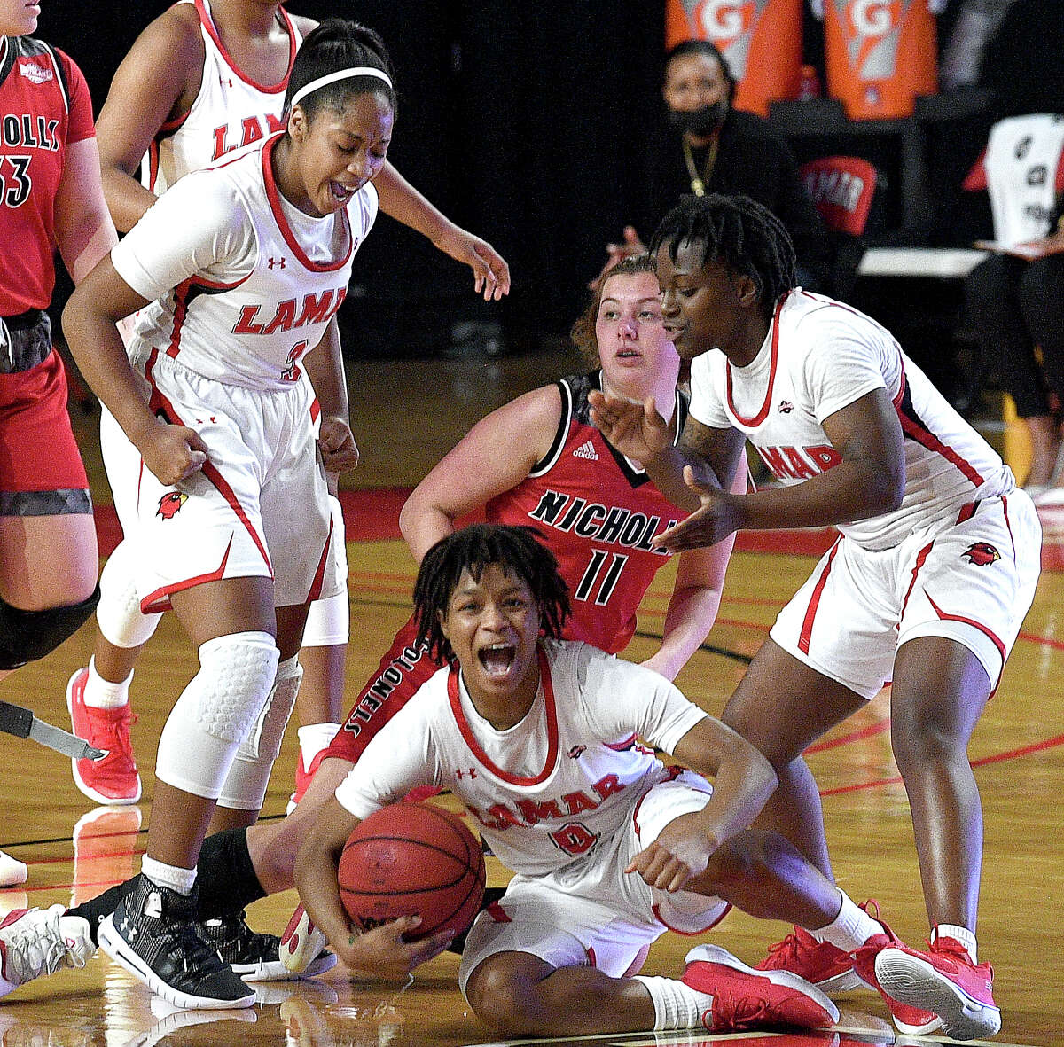 Lamar's Kayla Mitchell celebrates after forcing the turnover as they take on Nicholls State in their Southland Conference game opener at the Montagne Center Wednesday. Photo taken Wednesday, January 6, 2021 Kim Brent/The Enterprise