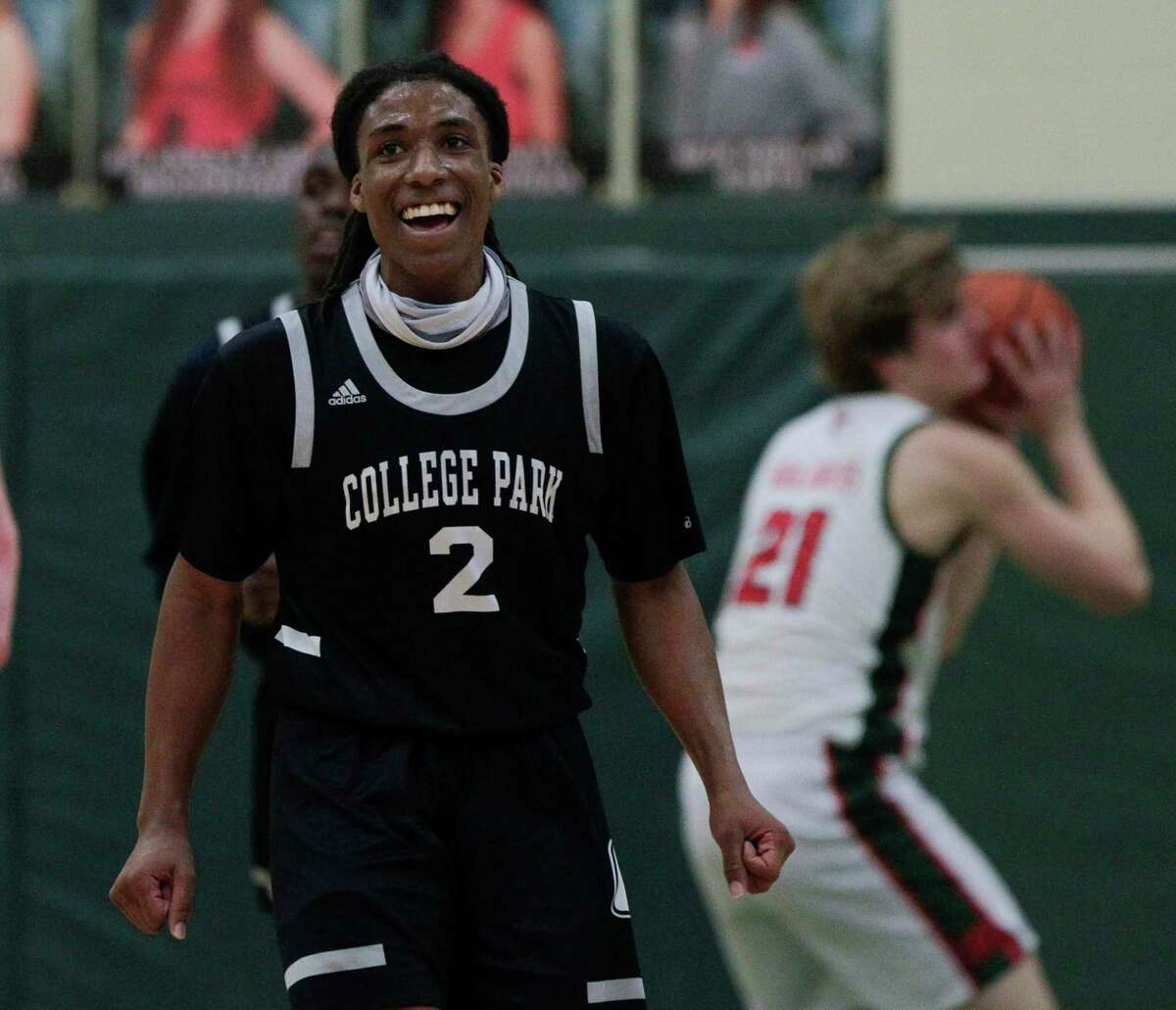 College Park guard Marvin Dock (2) shares a laugh during the second quarter of a District 13-6A high school basketball game at The Woodlands High School, Wednesday, Jan. 6, 2021, in The Woodlands.