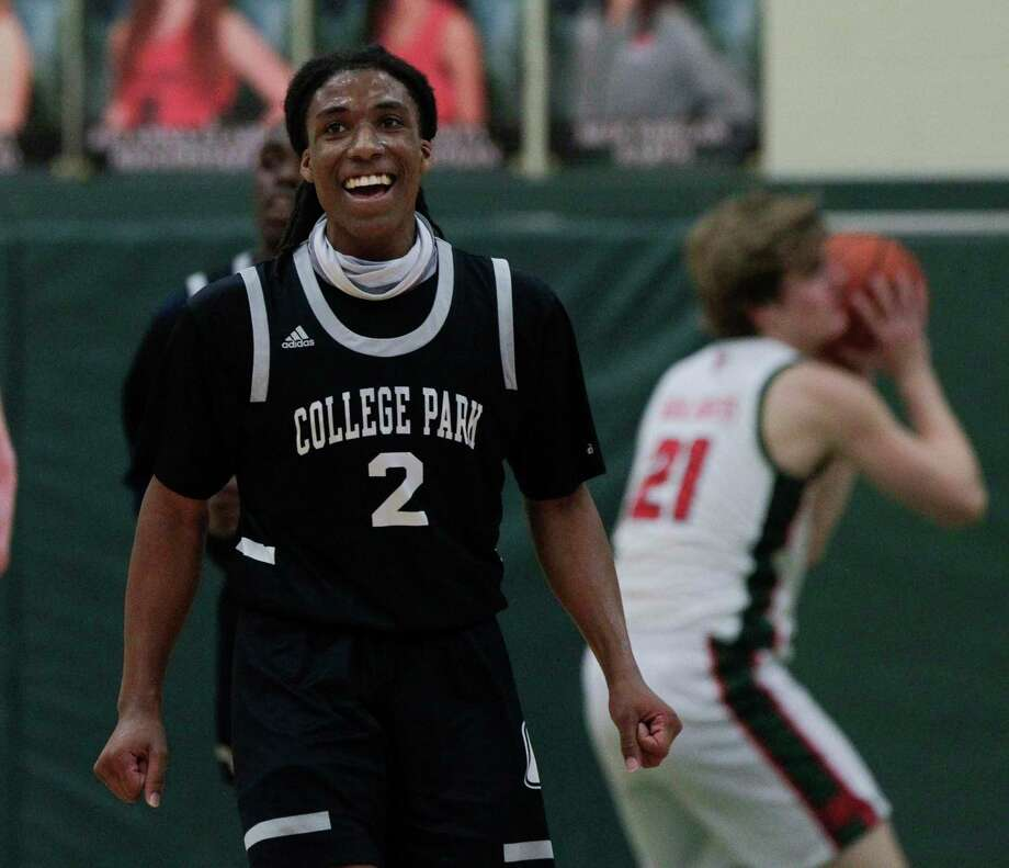 College Park guard Marvin Dock (2) shares a laugh during the second quarter of a District 13-6A high school basketball game at The Woodlands High School, Wednesday, Jan. 6, 2021, in The Woodlands. Photo: Jason Fochtman, Houston Chronicle / Staff Photographer / 2021 © Houston Chronicle