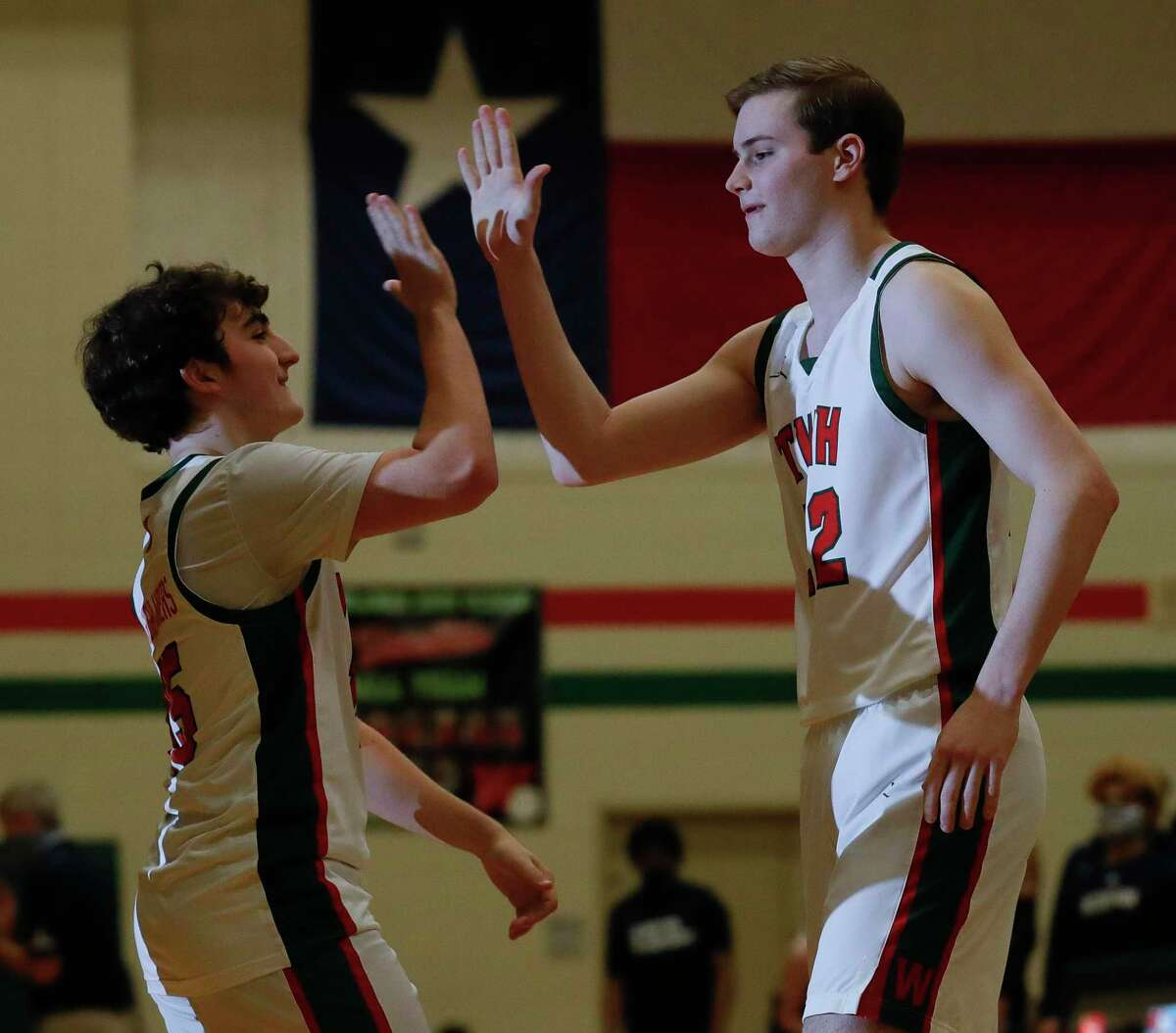 College Park guard Logan Maksimowicz (22) gets a high-five before the start of the first quarter of a District 13-6A high school basketball game at The Woodlands High School, Wednesday, Jan. 6, 2021, in The Woodlands.