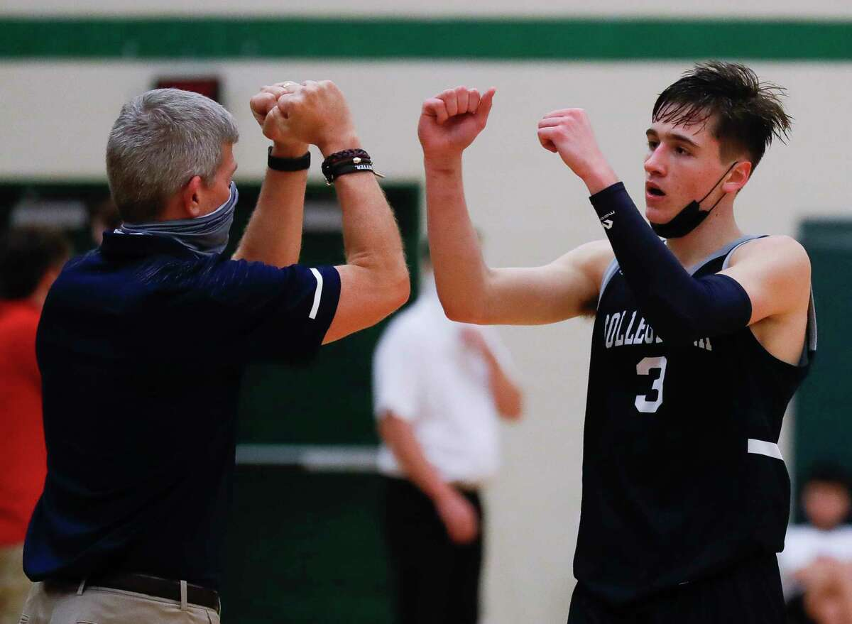 College Park guard Drew Calderon (3) gets a double-fist-bump from head coach Clifton McNeely during the fourth quarter of a District 13-6A high school basketball game at The Woodlands High School, Wednesday, Jan. 6, 2021, in The Woodlands.