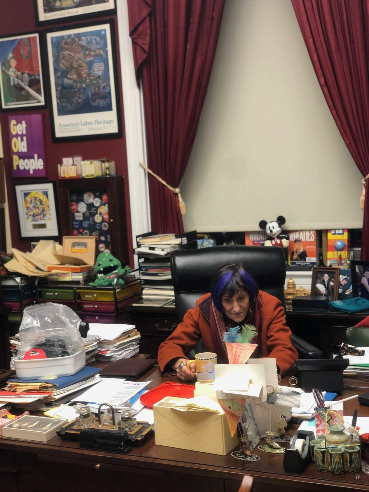 Rep. Rosa DeLauro, D-3 in her office, talking on the phone after the Capitol was cleared of rioters and lawmakers were released from lockdown. Her gas mask which she has to wear in the House chamber today is on her desk.