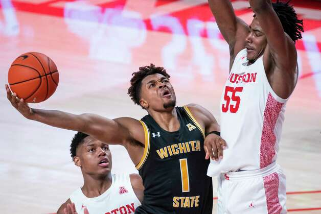 Houston Cougars forward Brison Gresham (55) tries to stop a shot by Wichita State Shockers guard Tyson Etienne (1) during the second half of the University of Houston Cougars' 70-63 win over the Wichita State Shockers on Wednesday, Jan. 6, 2021, at the Feritta Center in Houston. Photo: Mark Mulligan, Staff Photographer / © 2021 Mark Mulligan / Houston Chronicle