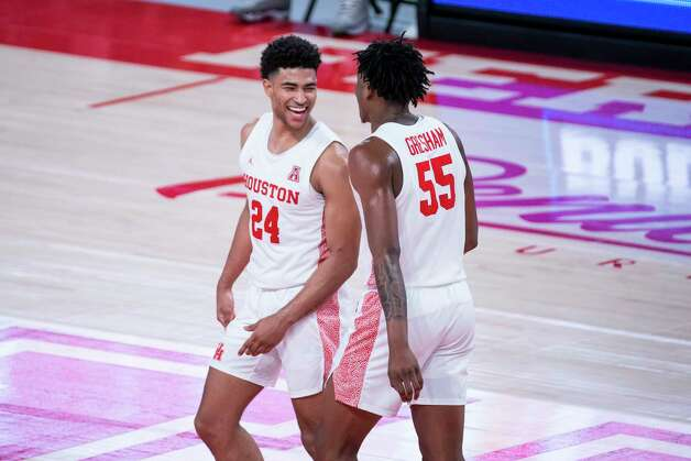 Houston Cougars guard Quentin Grimes (24) and forward Brison Gresham (55) celebrate a defensive stop during the second half of the University of Houston Cougars' 70-63 win over the Wichita State Shockers on Wednesday, Jan. 6, 2021, at the Feritta Center in Houston. Photo: Mark Mulligan, Staff Photographer / © 2021 Mark Mulligan / Houston Chronicle