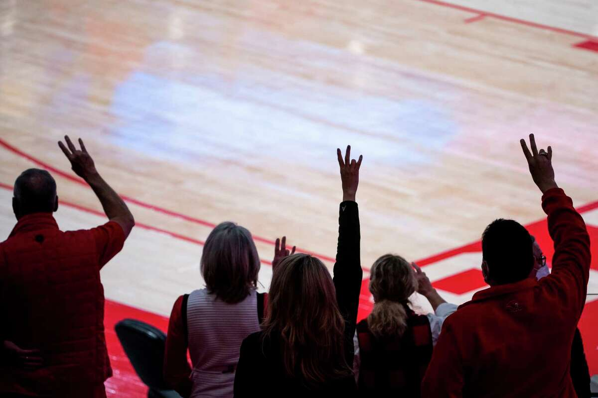 Cougar fans listen to the school song after the University of Houston Cougars' 70-63 win over the Wichita State Shockers on Wednesday, Jan. 6, 2021, at the Feritta Center in Houston.