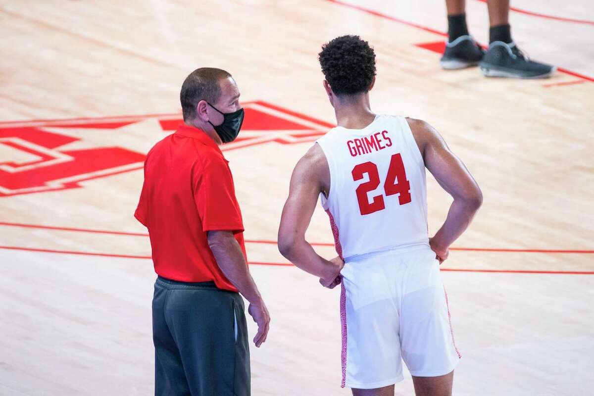 Houston head coach Kelvin Sampson talks with guard Quentin Grimes (24) during the second half of the University of Houston Cougars' 70-63 win over the Wichita State Shockers on Wednesday, Jan. 6, 2021, at the Feritta Center in Houston.