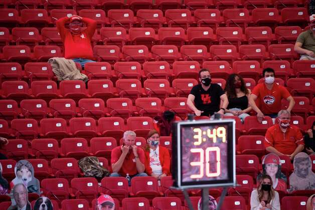 Houston fans watch from socially distanced stands during the second half of the University of Houston Cougars' 70-63 win over the Wichita State Shockers on Wednesday, Jan. 6, 2021, at the Feritta Center in Houston. Photo: Mark Mulligan, Staff Photographer / © 2021 Mark Mulligan / Houston Chronicle