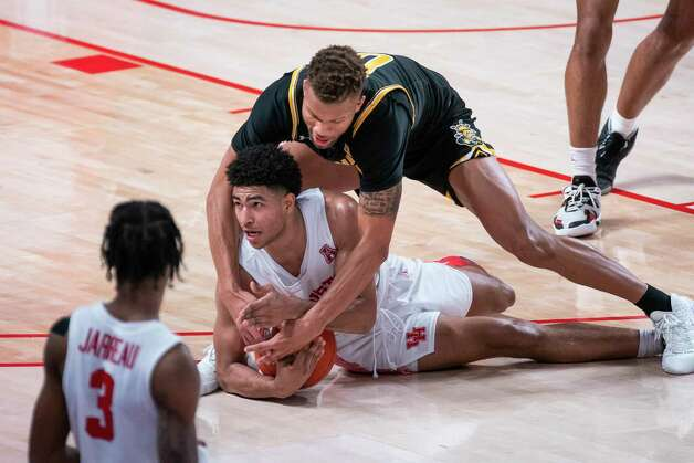Houston Cougars guard Quentin Grimes (24) calls a timeout after grabbing a loose ball during the second half of the University of Houston Cougars' 70-63 win over the Wichita State Shockers on Wednesday, Jan. 6, 2021, at the Feritta Center in Houston. Photo: Mark Mulligan, Staff Photographer / © 2021 Mark Mulligan / Houston Chronicle
