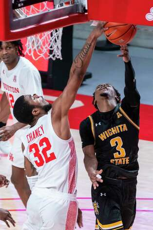 Houston Cougars forward Reggie Chaney (32) blocks a shot by Wichita State Shockers guard Alterique Gilbert (3) during the second half of the University of Houston Cougars' 70-63 win over the Wichita State Shockers on Wednesday, Jan. 6, 2021, at the Feritta Center in Houston. Photo: Mark Mulligan, Staff Photographer / © 2021 Mark Mulligan / Houston Chronicle