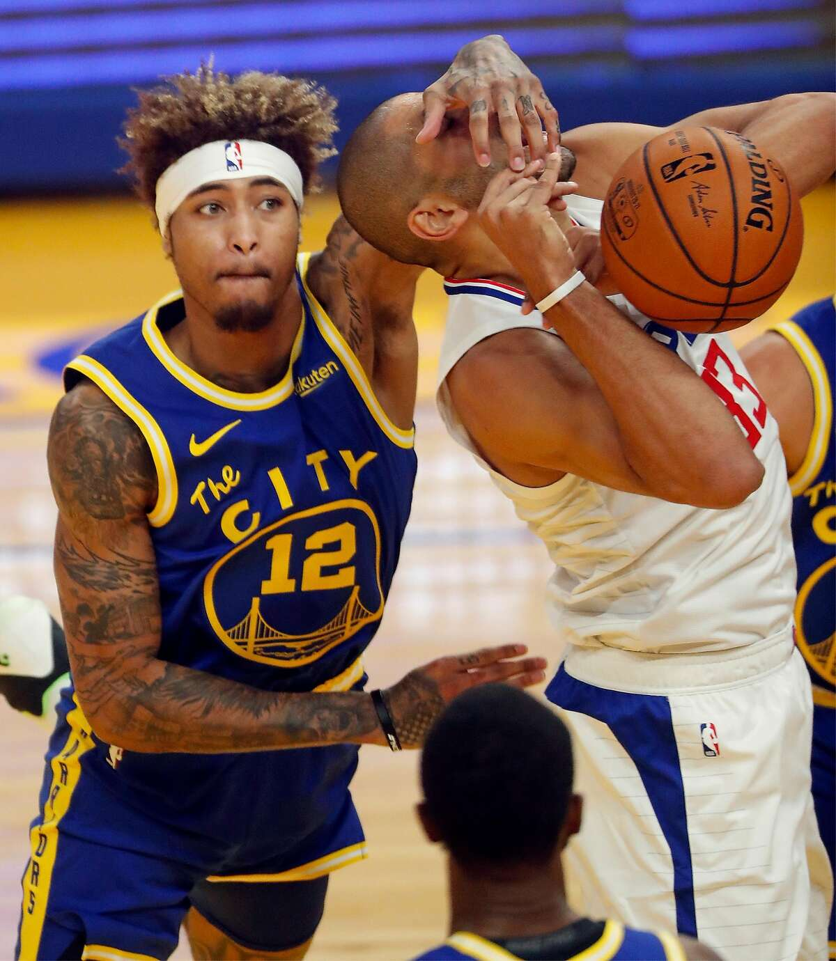 Golden State Warriors' Kelly Oubre, Jr. fouls Los Angeles Clippers' Nicolas Batum in 1st quarter during NBA game at Chase Center in San Francisco, Calif., on Wednesday, January 6, 2021.