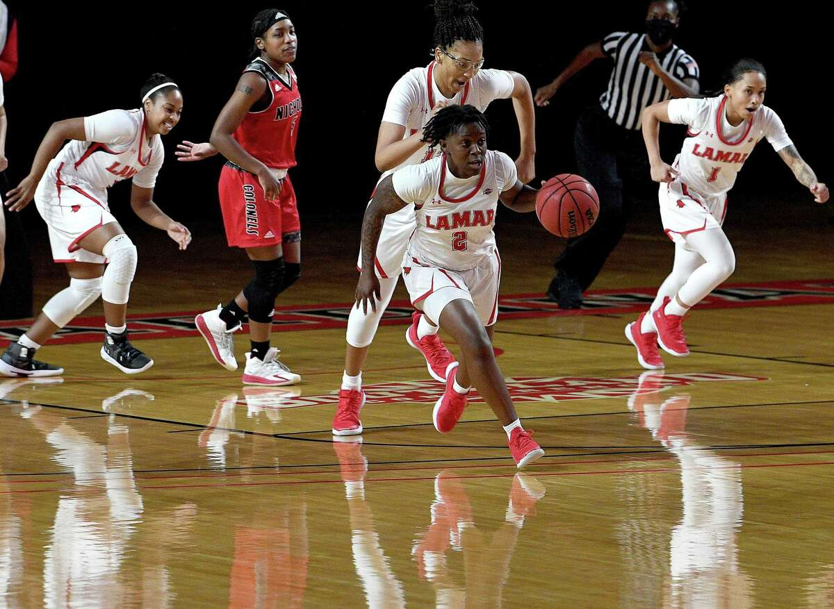 Lamar's Angel Hastings runs the ball as they take on Nicholls State in their Southland Conference game opener at the Montagne Center Wednesday. Photo taken Wednesday, January 6, 2021 Kim Brent/The Enterprise