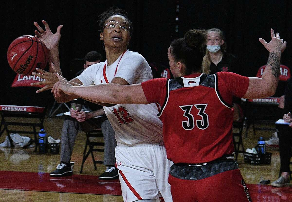 Lamar's Micaela Wilson has her shot denied by Nicholls State's Bryanna Washington in their Southland Conference game opener at the Montagne Center Wednesday. Photo taken Wednesday, January 6, 2021 Kim Brent/The Enterprise