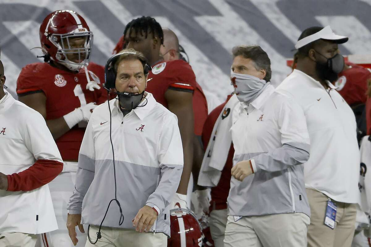 Alabama head coach Nick Saban and Alabama assistant coach Steve Sarkisian work from the sidelines as Alabama plays Notre Dame in the Rose Bowl NCAA college football game in Arlington, Texas, Friday, Jan. 1, 2021. (AP Photo/Ron Jenkins)