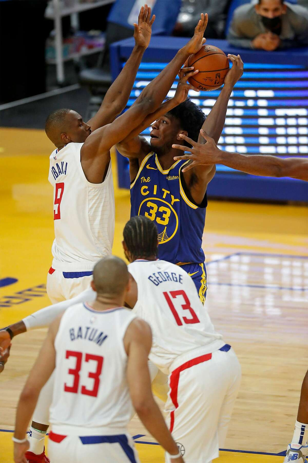 Golden State Warriors' James Wisemna is guarded by Los Angeles Clippers' Serge Ibaka in 2nd quarter during NBA game at Chase Center in San Francisco, Calif., on Wednesday, January 6, 2021.