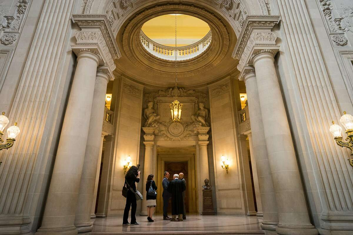 A marriage ceremony takes place in the rotunda of San Francisco City Hall, a masterpiece of Beaux Arts classicism where a supervisor and mayor were assassinated in 1978.