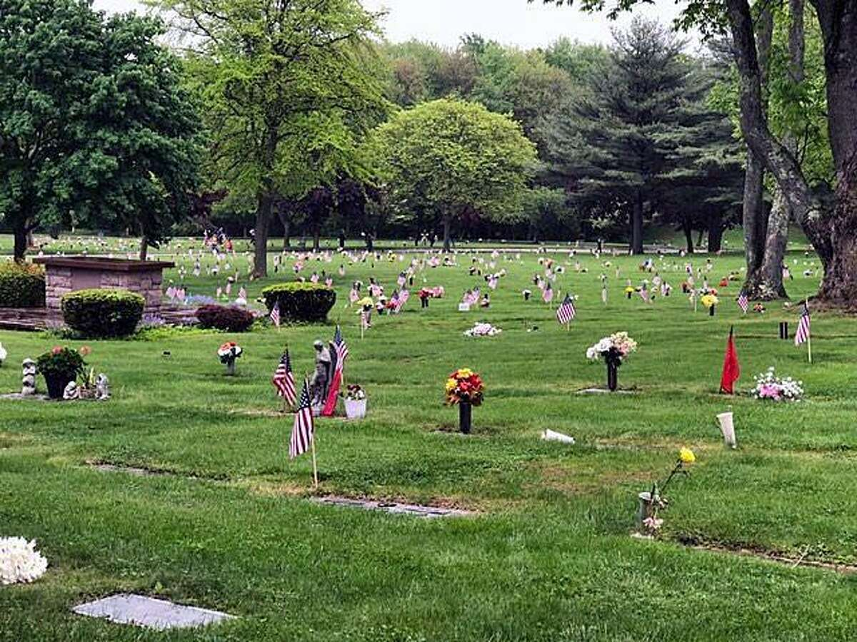 Flags mark the grave markers of veterans at Gate of Heaven Cemetery on May 22, 2018.