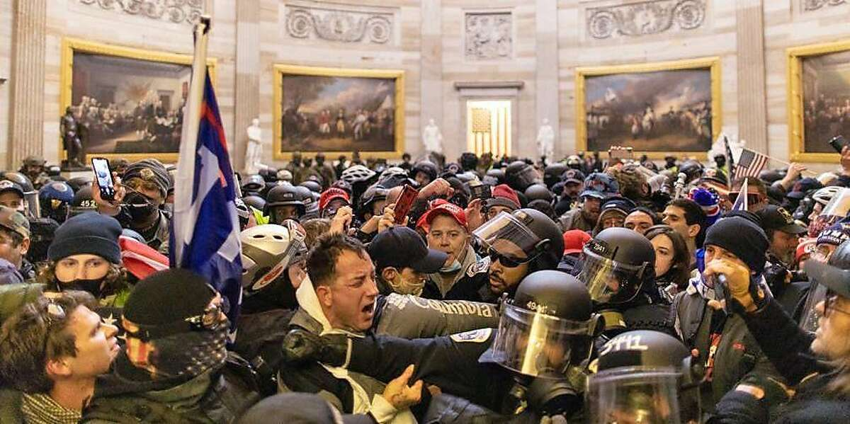 Police intervene in US President Donald Trumps supporters who breached security and entered the Capitol building in Washington D.C., United States on January 06, 2021. Pro-Trump rioters stormed the US Capitol as lawmakers were set to sign off Wednesday on President-elect Joe Biden's electoral victory in what was supposed to be a routine process headed to Inauguration Day.