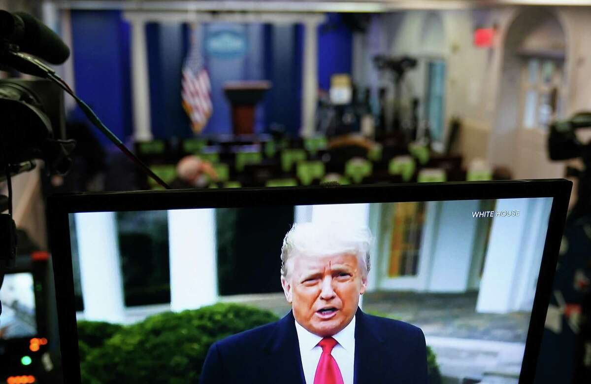 """U.S. President Donald Trump is seen on TV from a video message released on Twitter addressing rioters at the U.S. Capitol, in the Brady Briefing Room at the White House in Washington, D.C. on Wednesday, Jan. 6, 2020. Trump told his supporters on Wednesday to """"go home"""" after they stormed the U.S. Capitol following a rally during which he repeated his spurious claims of election fraud. (Mandel Ngan/AFP/Getty Images/TNS)"""
