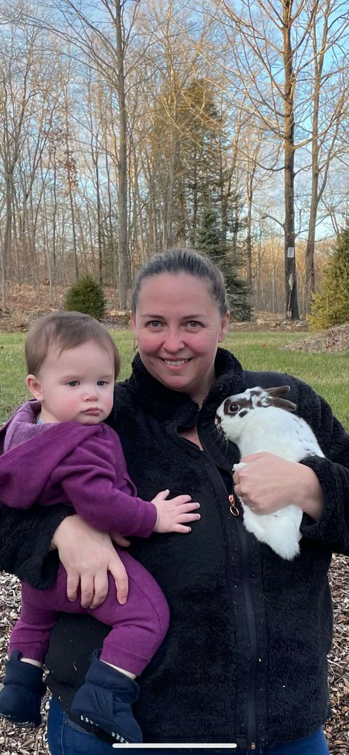 Heidi Latka, with her daughter Charley and rescued rabbit, Rip