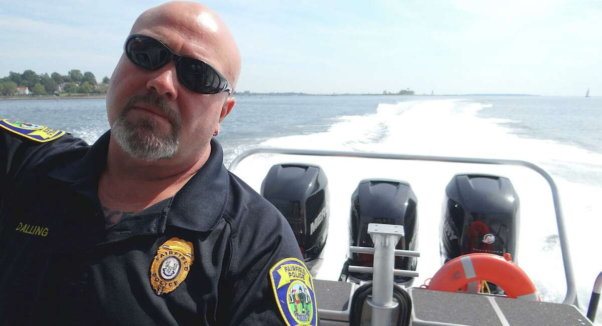 Marine Police Officer Grant Dalling aboard Fairfield's high-speed Marine Unit 1 Saturday during a tour with RTM members.
