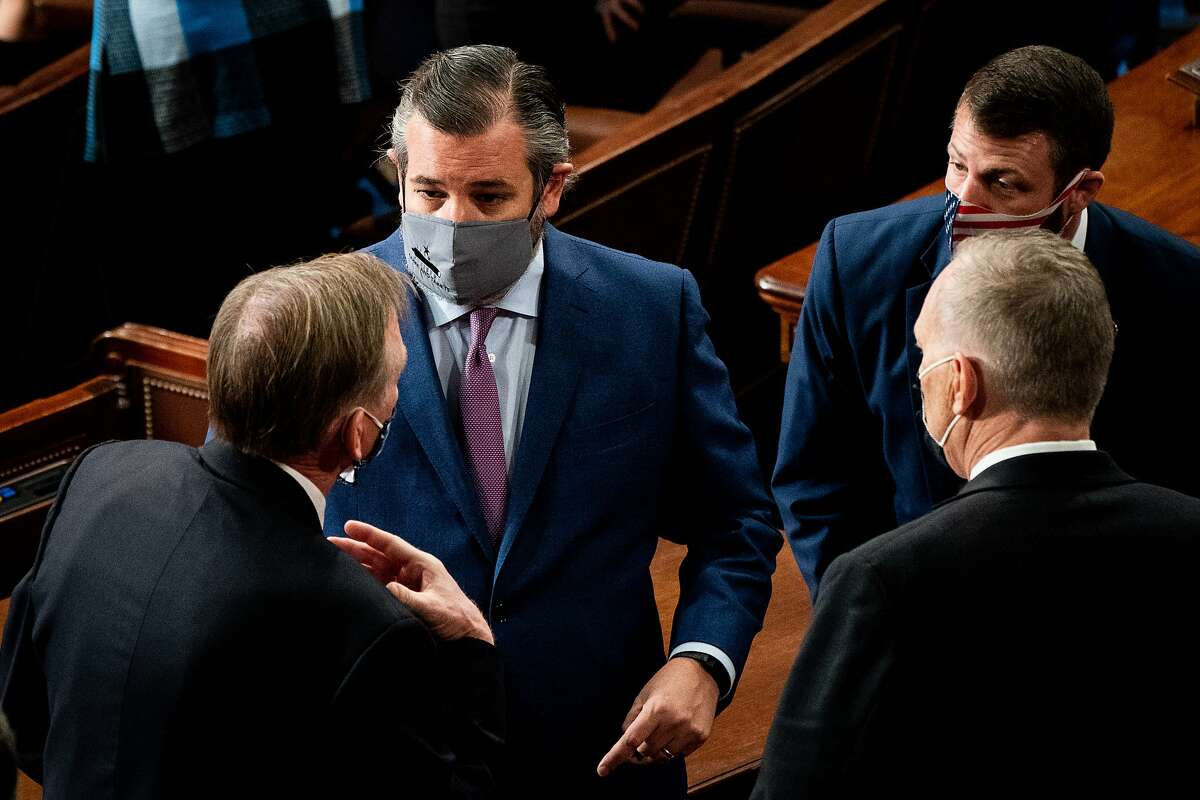 Sen. Ted Cruz (R-TX) talks with house members during a joint session of Congress to certify the 2020 Electoral College results on January 6, 2021 in Washington, DC.