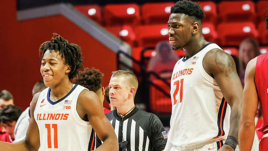 Illini players Ayo Dosunmu, left, and Kofi Cockburn are all smiles during a game earlier this season inside the State Farm Center in Champaign.