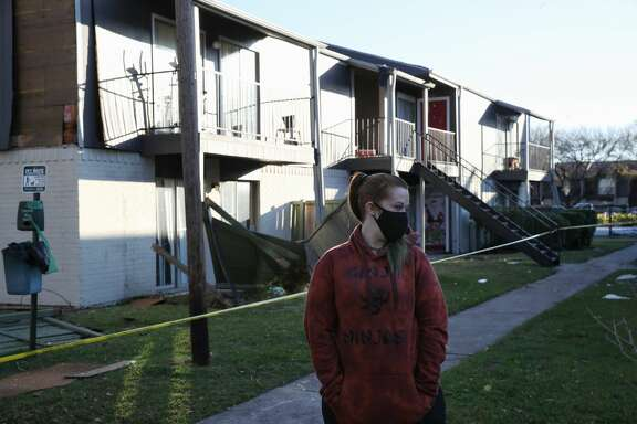 "Jamie Johnson becomes emotional as she looks at storm damage to her apartment complex Thursday, Jan. 7, 2021, in Texas City. ""That's a lot to see,"" she said."