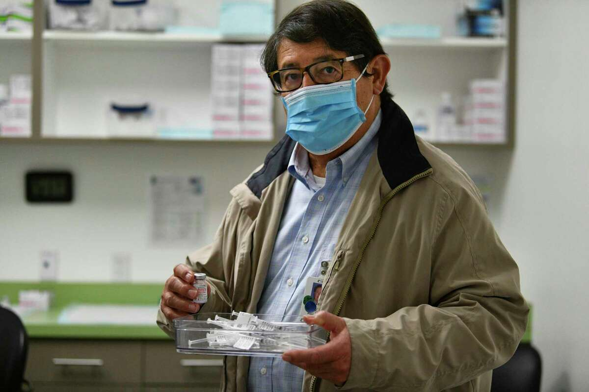 George B. Hernández Jr., president and CEO of University Health, holds a tray of Moderna COVID-19 syringes at Wonderland of the Americas mall on Wednesday, Jan. 6, 2020, where the public health system is having a mass vaccination clinic by appointment only. All appointments are already reserved; no date has been set for the next vaccine event.