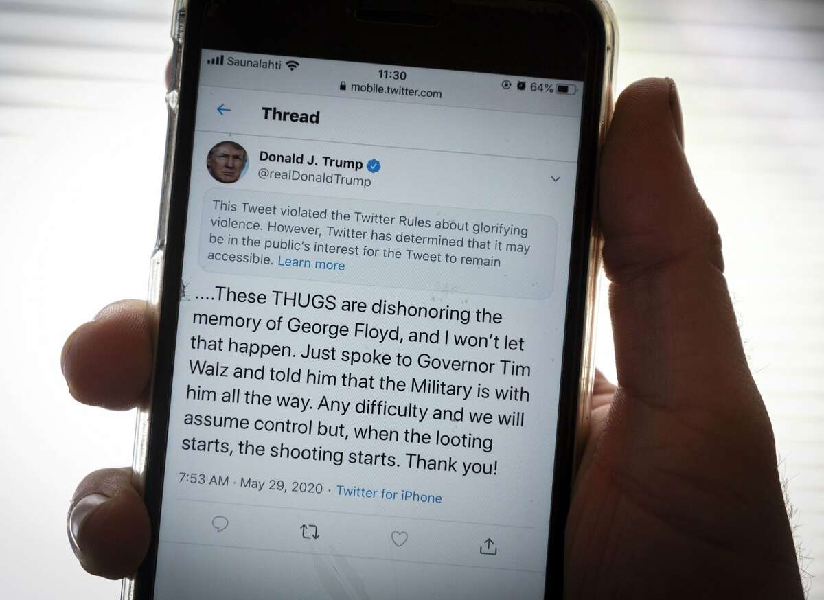 President Trump's Twitter page is displayed on a mobile phone. The social media company flagged one of his tweets about Minneapolis as