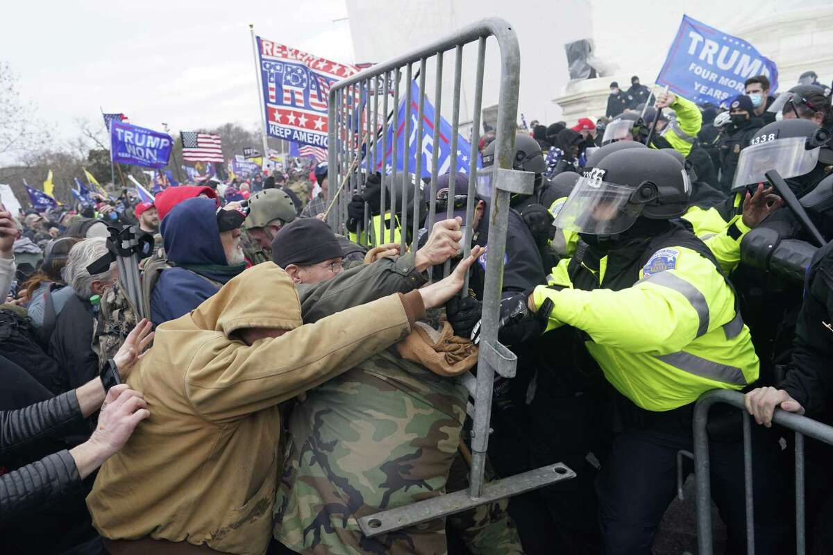 Protesters battle with the police on Wednesday outside the United States Capitol building.