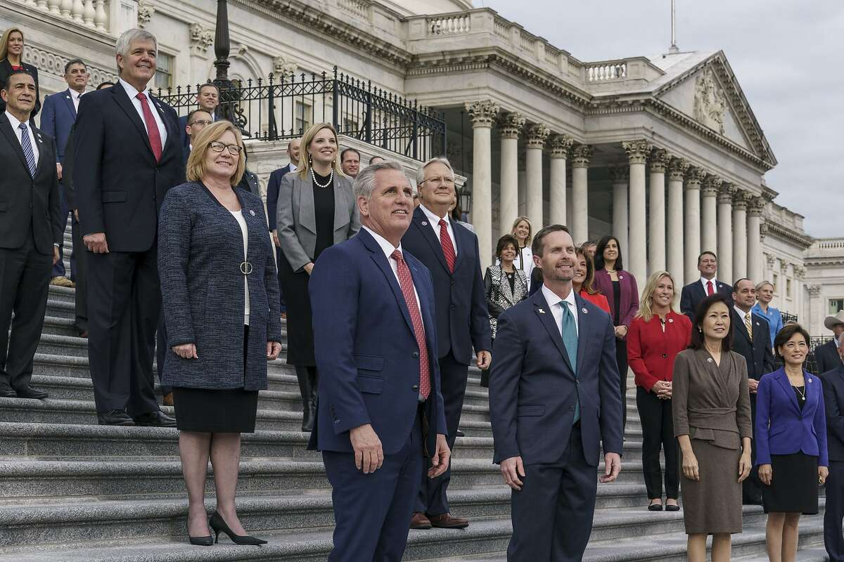House Republican leader Kevin McCarthy of Bakersfield (center) with new Republican House members at the Capitol in Washington on Monday.