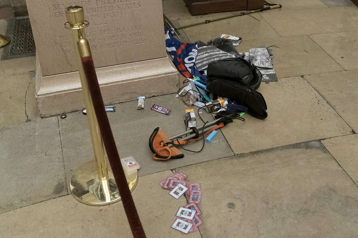 Debris and personal belongings are strewn across the floor of the Rotunda in the early morning hours after Trump supporters stormed the Capitol on Wednesday in Washington, Thursday, Jan. 7, 2021.