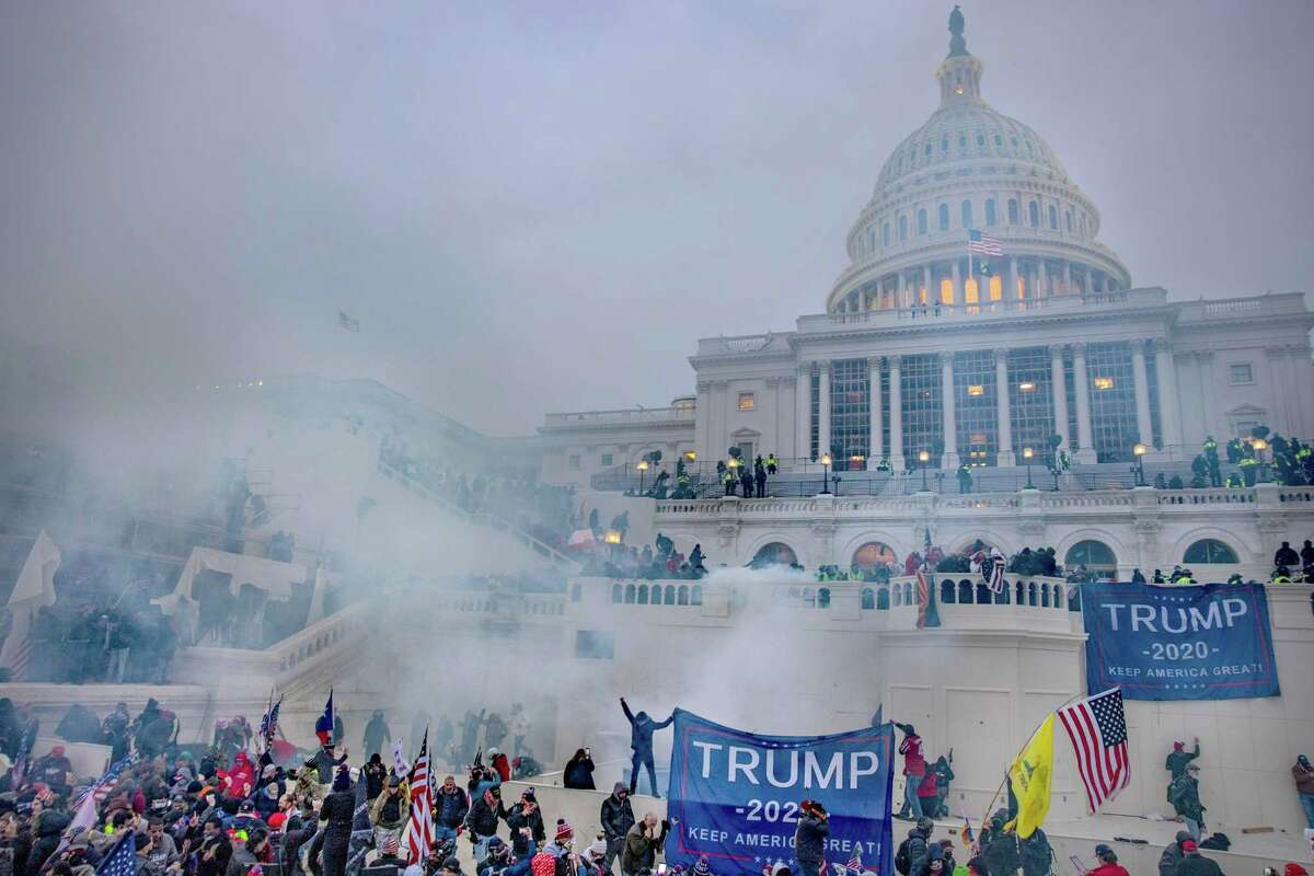 Tear gas engulfs the crowd in front of the Capitol.