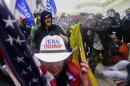 Trump supporters try to break through a police barrier on Wednesday, Jan. 6, 2021, at the Capitol in Washington, D.C.