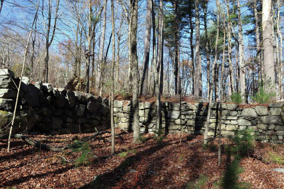 Foundations and walls can be seen along the Saugatuck Trail. Today, the land surrounding the 12-billion gallon reservoir is part of the Centennial Watershed State Forest created in 2002 when the state Department of Energy and Environmental Protection, The Nature Conservancy and Aquarion Water Co. agreed to preserve 15,300 acres in Easton, Newtown, Redding and Weston. The $90 million sale was the biggest land acquisition in the state's history. The centennial was in honor of Connecticut's 100th anniversary of the state forest system.