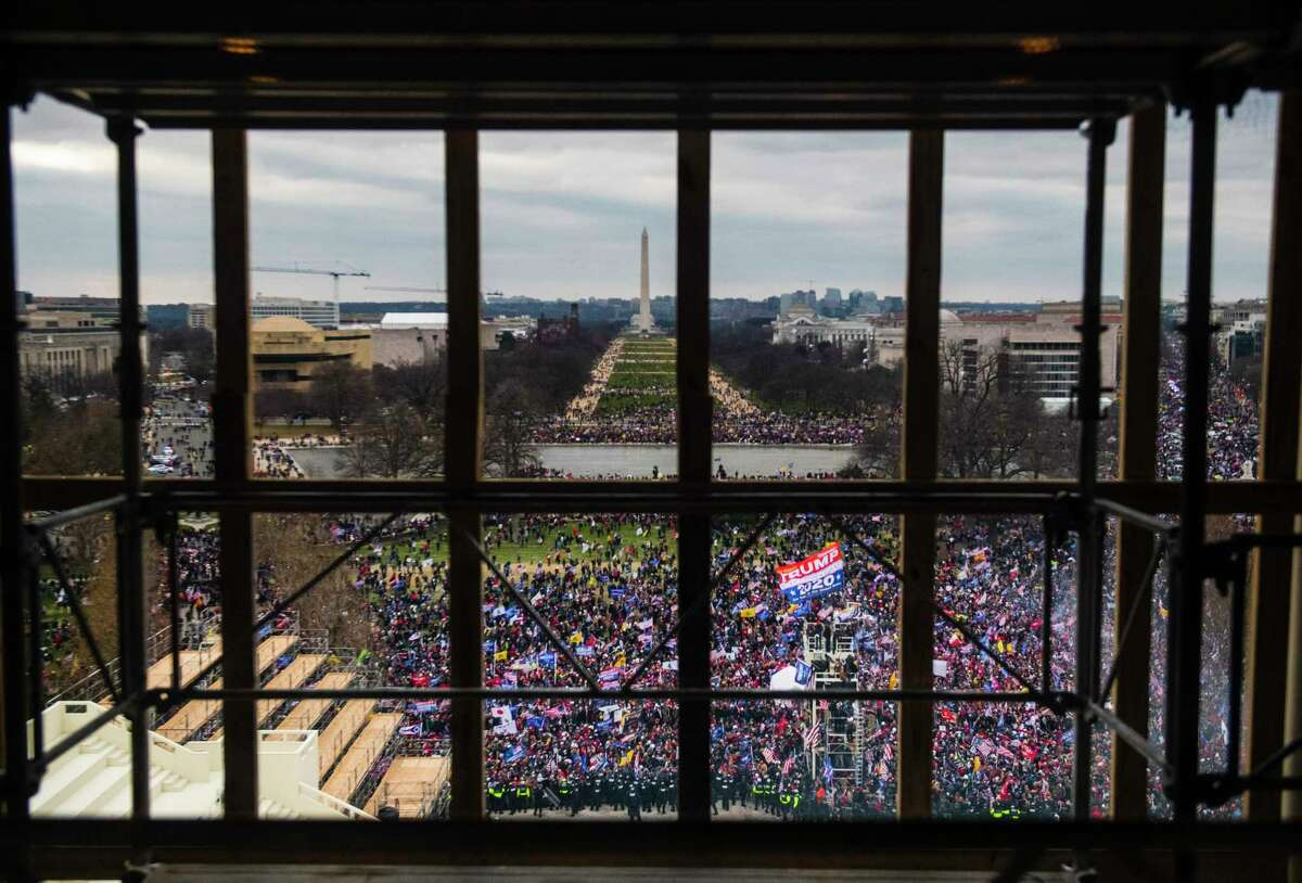 Rioters surround the Capitol on Wednesday, Jan. 6, 2021.