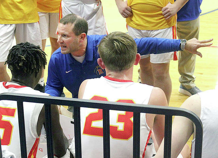 Roxana AD and boys basketball coach Mark Briggs gives his team instructions a game last season against Okawville at Larry Milazzo Gym in Roxana. Photo: Pete Hayes   The Telegraph