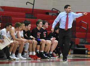 New Canaan head coach Danny Melzer directs the Rams during their 52-49 victory over Stamford at NCHS on Jan. 10.