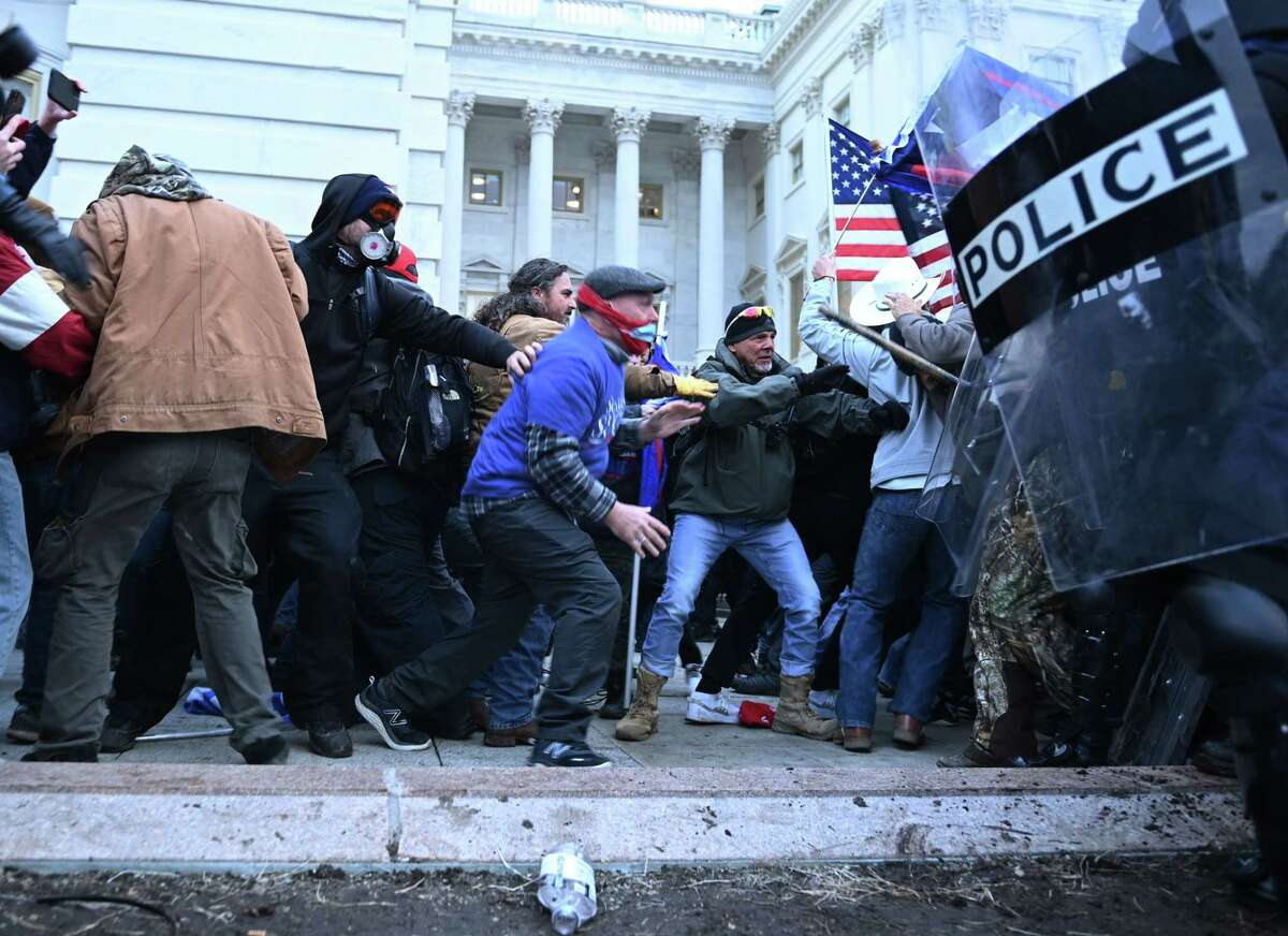 Trump supporters clash with police and security forces Wednesday. U.S. Sen. Ted Cruz needs to be held responsible for his role in instigating this insurrection.