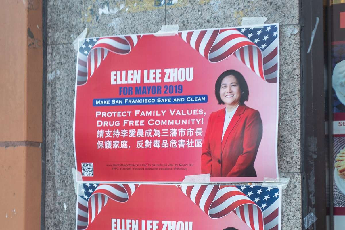 Paper signs on a wall for mayoral candidate Ellen Lee Zhou, with text in both English and Chinese, in the Chinatown neighborhood of San Francisco, Nov. 8, 2019.