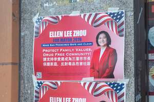 Paper signs on a wall for mayoral candidate Ellen Lee Zhou, with text in both English and Chinese, in the Chinatown neighborhood of San Francisco, California, November 8, 2019. (Photo by Smith Collection/Gado/Getty Images)