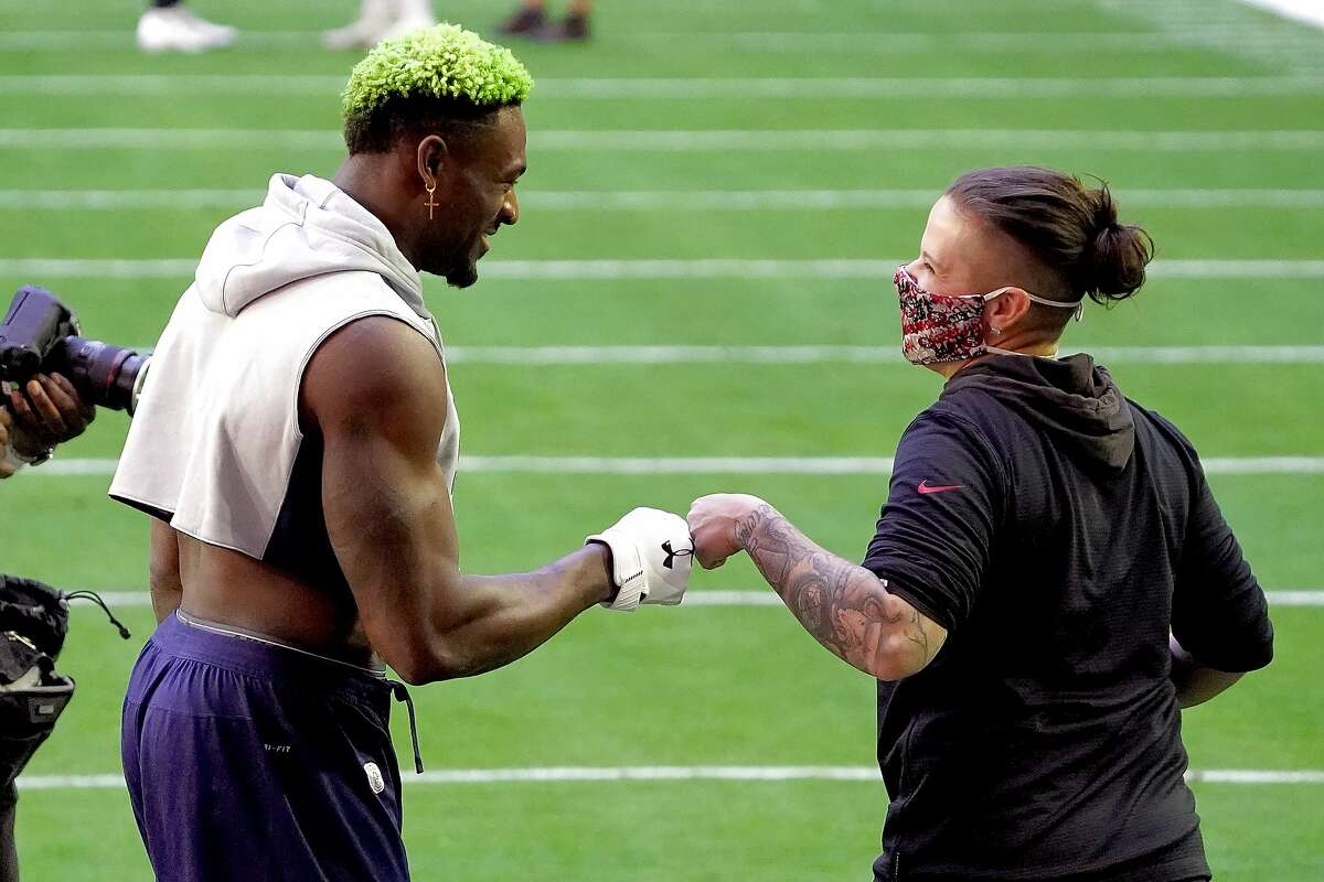 Seattle Seahawks wide receiver DK Metcalf is greeted by San Francisco 49ers offensive assistant coach Katie Sowers prior to an NFL football game, Sunday, Jan. 3, 2021, in Glendale, Ariz.