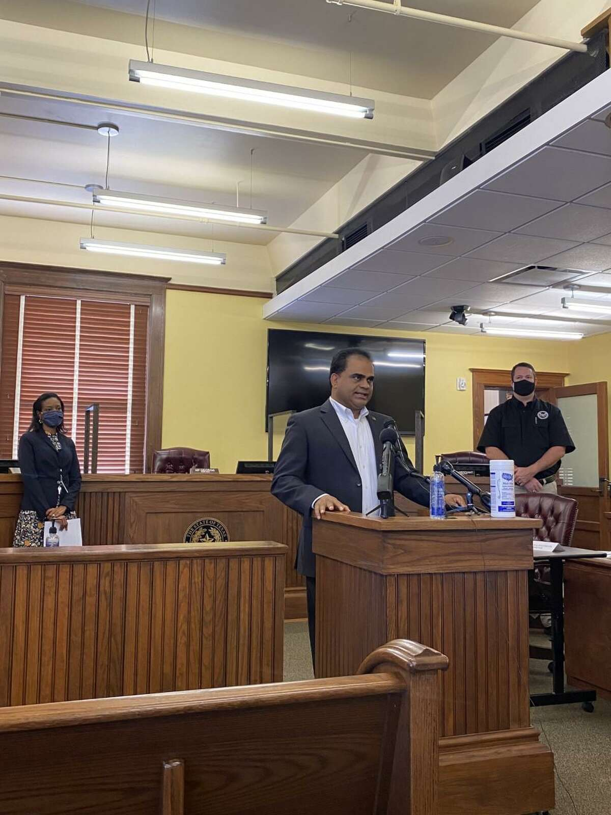 County Judge KP George, accompanied by Dr. Jacquelyn Johnson-Minter and emergency management coordinator Mark Flathouse provide an update on the COVID-19 vaccine for Fort Bend County residents in early January 2021.