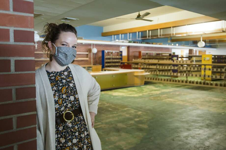 Grace A. Dow Memorial Library Director Miriam Andrus poses for a portrait inside the children's section of the library Wednesday, Jan. 6, 2021. The library is still undergoing renovations after sustaining severe damage during the mid-Michigan dam failures and flood in May. (Katy Kildee/kkildee@mdn.net) Photo: (Katy Kildee/kkildee@mdn.net)