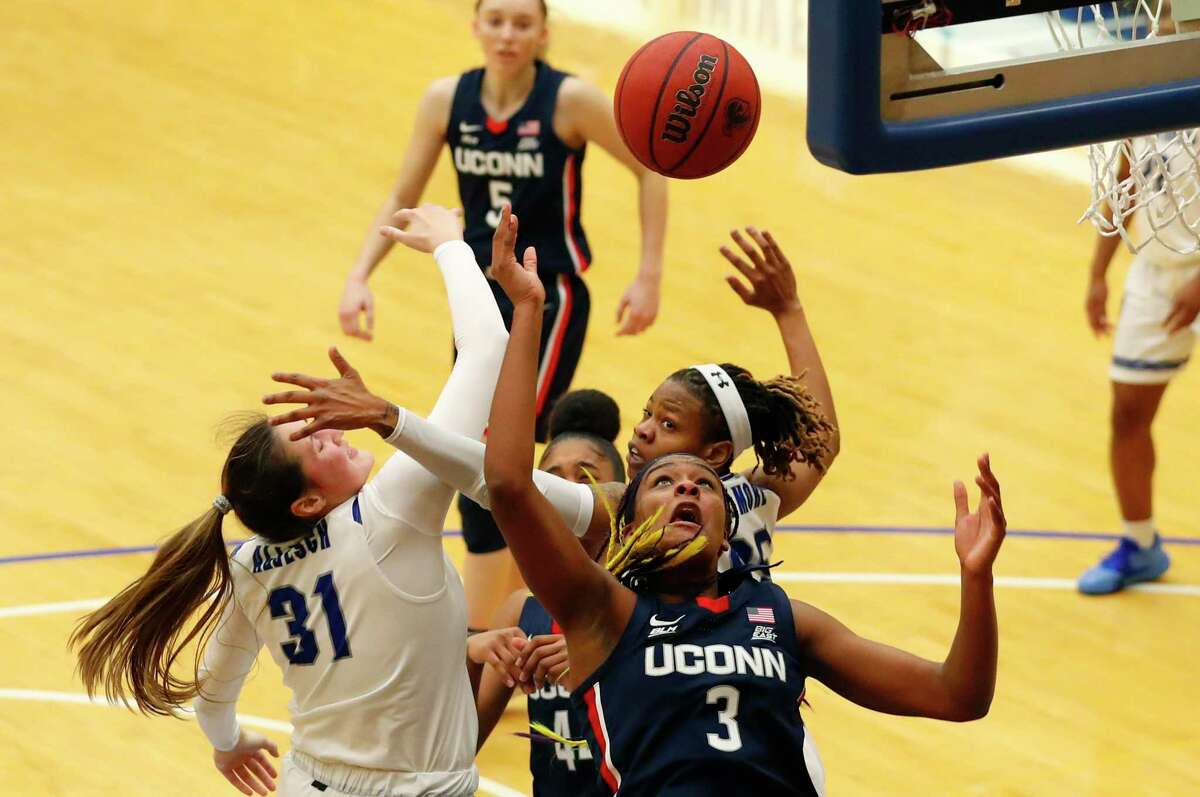 Seton Hall forward Alexia Allesch (31) and UConn forward Aaliyah Edwards (3) battle for a rebound during the second half of an NCAA basketball game on Tuesday, Dec.15, 2020, in South Orange, N.J. UConn won 92-65. (AP Photo/Noah K. Murray)